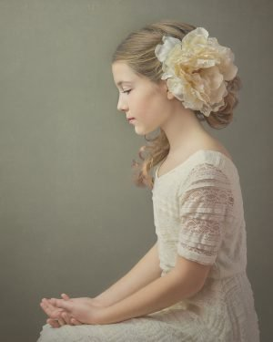 painterly style portrait of a girl wearing a vintage lace dress with flower in her hair