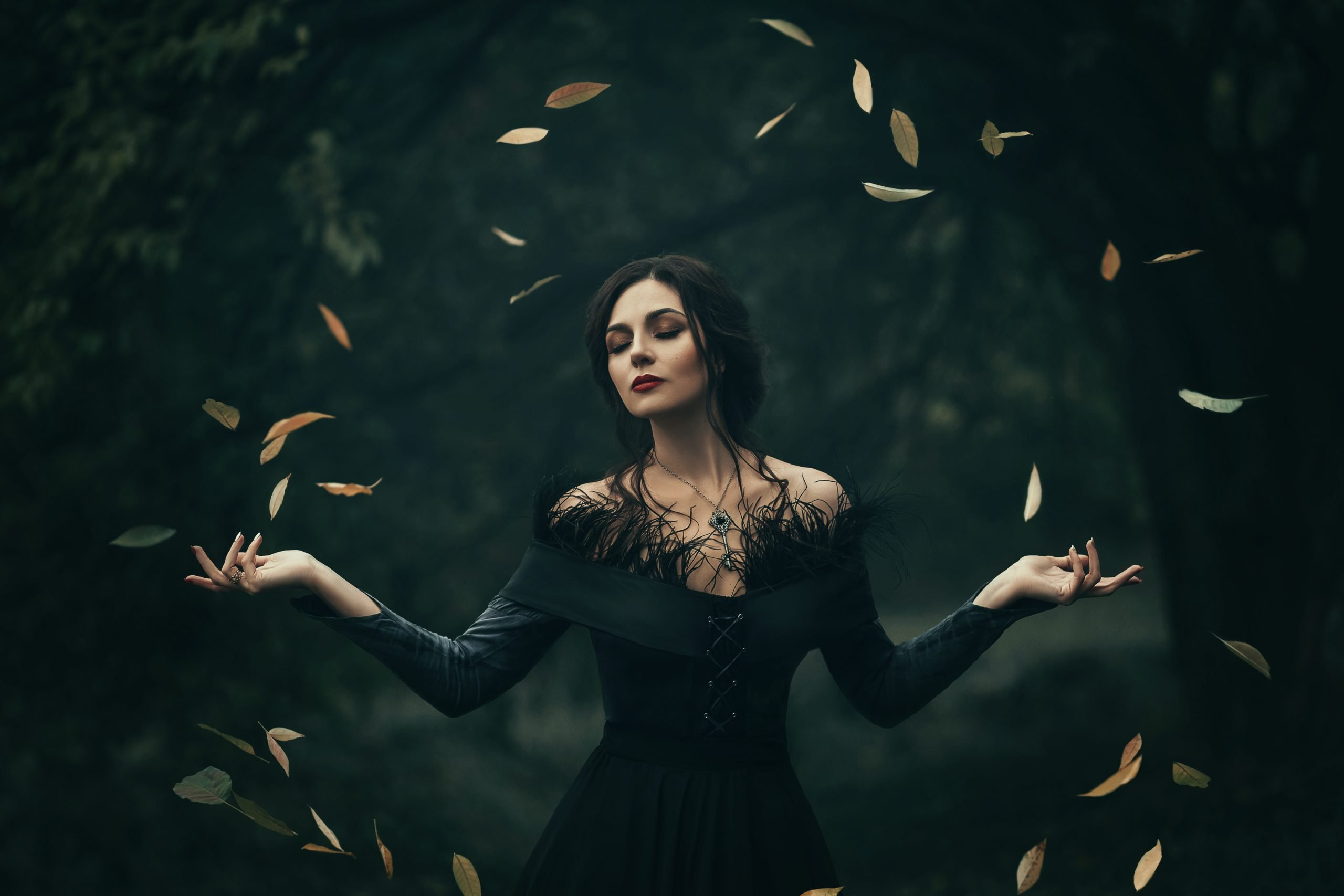 fantasy portrait of beautiful woman in black dress with bat wing overlay