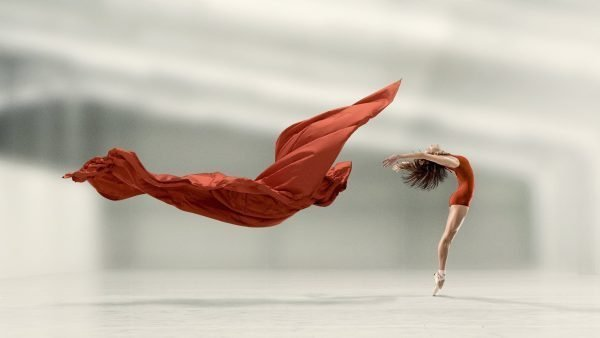 dancer with floating red fabric overlay