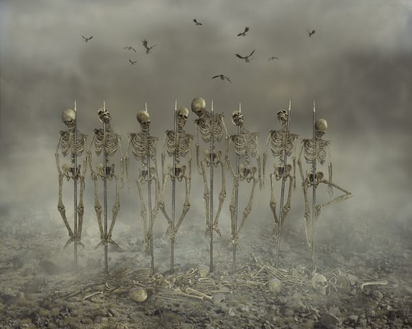 composite photography made in photoshop of skeletons in a row mounted on spears using a digital background from the Halloween Collection from Alana Lee