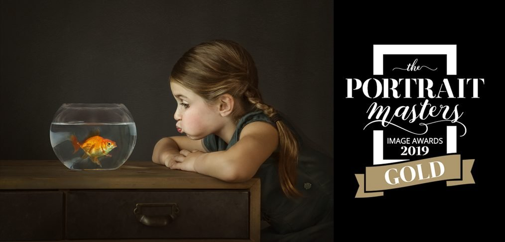 Gold award winning image by Alana Lee of girl and her goldfish that won the pet category in the January 2019 Portrait Masters photography awards