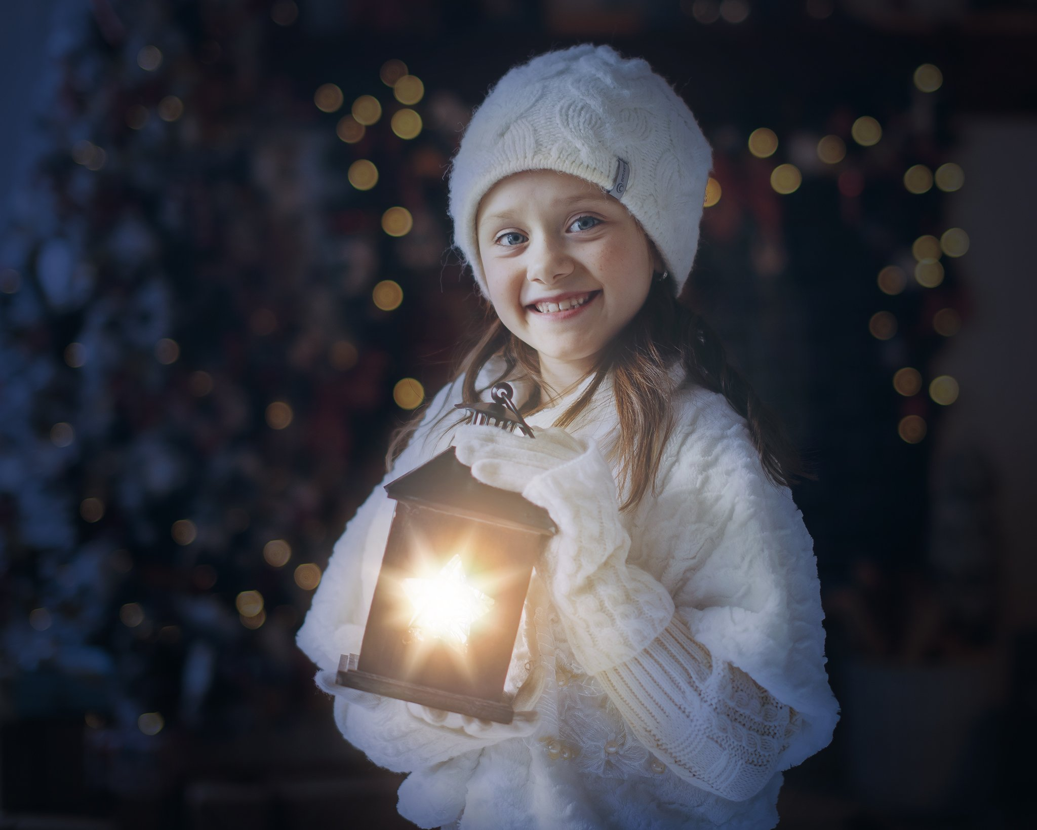 girl holding a lantern with a light overlay added in photoshop