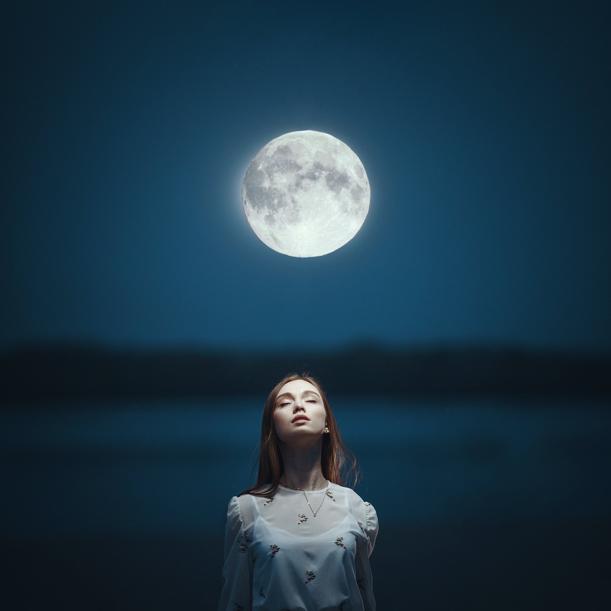 image of girl looking at moon with star and cloud overlays added using photoshop