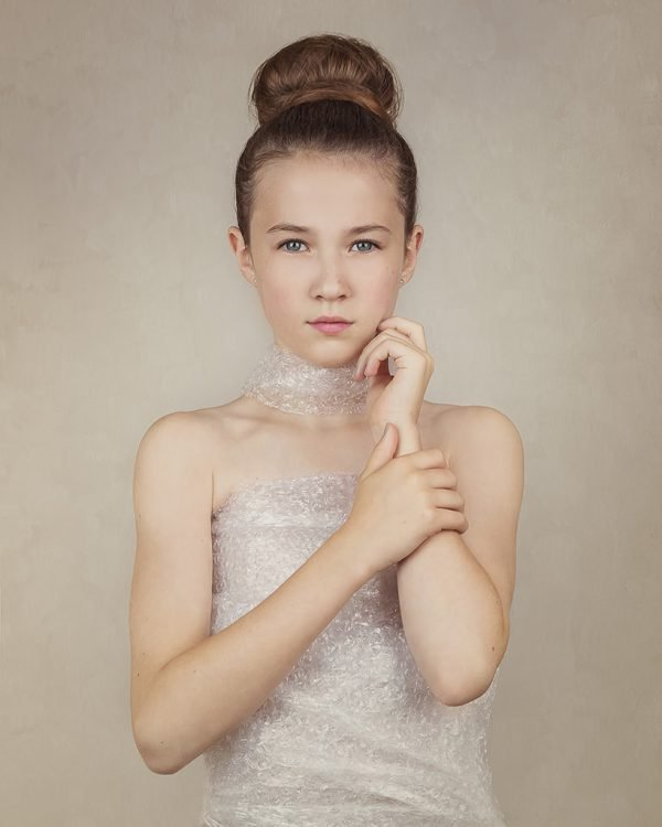 award winning image by Alana Lee of a portrait of girl wearing dress made out of bubble wrap