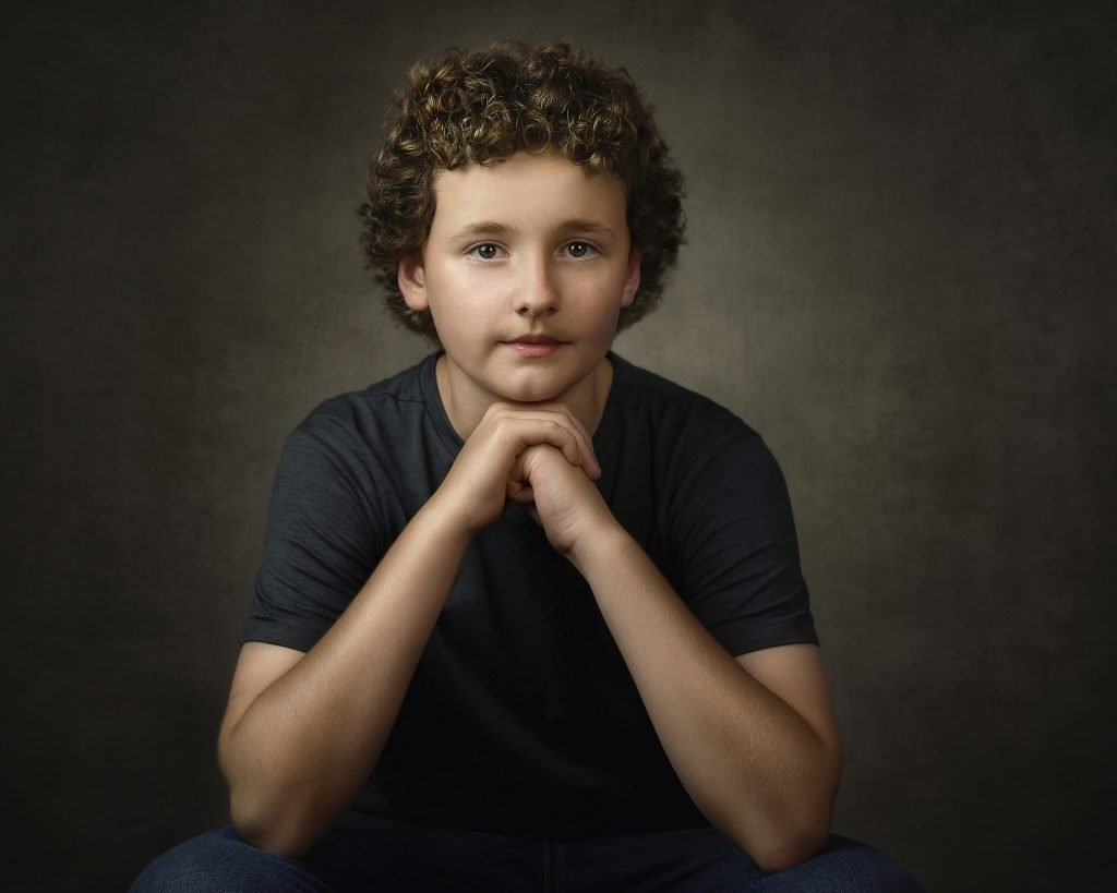 portrait of a boy with curly hair by Alana Lee