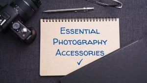 flatlay of photography journal with the essential photography accessories