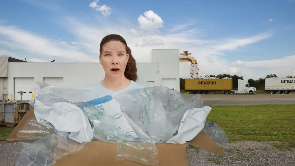 Photoshop composite image created by Alana Lee illustrating distraught woman holding massive amounts of plastic packaging material from Amazon shopping